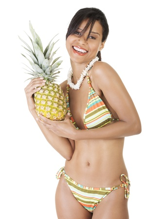 Happy summer woman in bikini with pineapple  Isolated on white photo