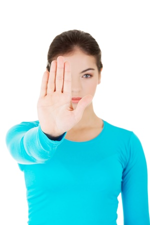 forceful: Hold on, Stop gesture showed by young woman hand Stock Photo