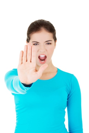 showed: Hold on, Stop gesture showed by young woman hand Stock Photo