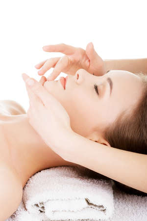 health and beauty: Beautiful young relaxed woman enjoy receiving face massage at spa saloon