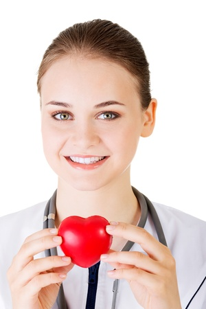 Female doctor holding red heart in hand. Isolated on white background  photo