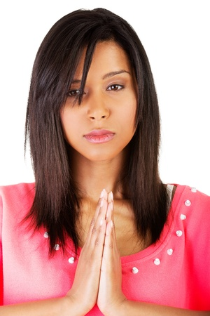 Young pretty woman praying, over white background. photo
