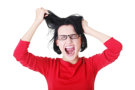going crazy: Woman stressed is going crazy pulling her hair in frustration.