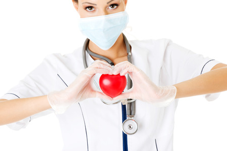 Young nurse with heart in her hand , isolated on white. photo