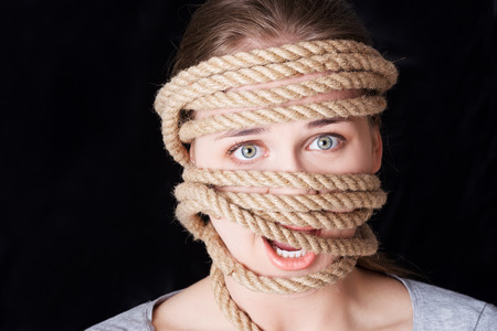 cry for help: Tied up woman screaming. Violence concept.