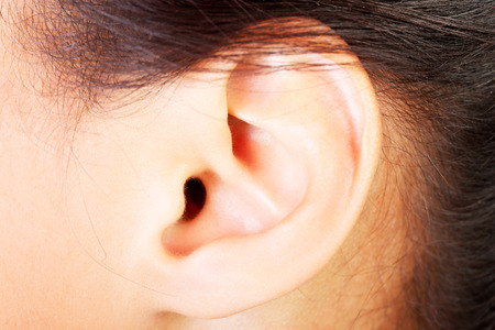 Young woman ear closeup.  photo