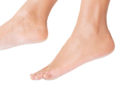 Beautiful caucasian woman feet. Isolated over white background  photo