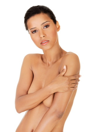 african american nude: Beautiful fit topless woman, isolated on white  Stock Photo