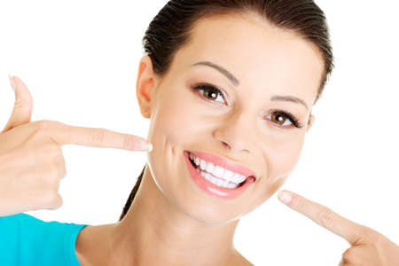 toothy: Woman showing her perfect straight white teeth.
