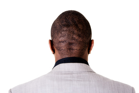 Black male head, back view. Isolated on white.  photo