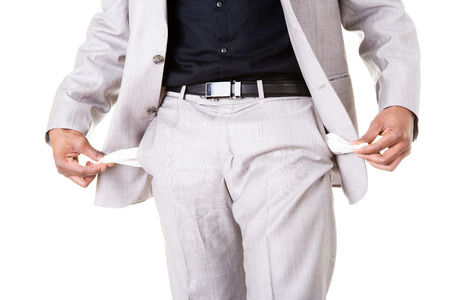hands on pockets: Male businessman showing open pockets. Isolated on white.