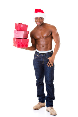 Handsome nude man holding gifts and holding santa hat. Isolated on white.  photo