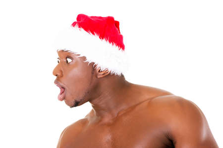 Attractive profile of a man wearing a santa hat.  Isolated on white.  photo