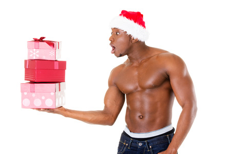 Attractive handsome nude man holding present in excitment. Isolated on white.  photo