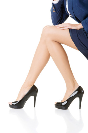 Female legs, Closeup. High heels. Isolated on white.  photo