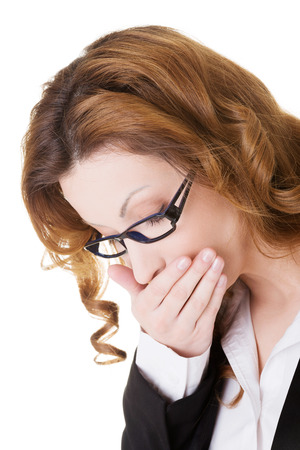 Business woman covering her mouth in nausea.  photo