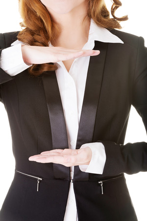 Business woman having hands in front of her belly,empty space. Isolated on white.  photo
