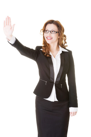 raised hand: Business woman with raised hand. Isolated on white.