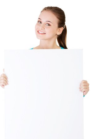 Attractive woman holding a poster with copy space. Isolated on white.  photo