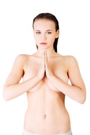 Attractive, beautiful naked woman with hands together, covering her breasts. Front view. isolated on white.  photo
