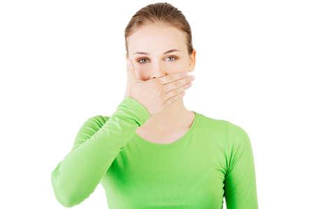 mouth closed: Atractiva mujer tap�ndose la boca. Aislado en blanco. Foto de archivo