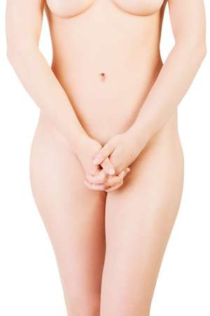 Womans naked body. Front view. Closeup. Isolated on white.
