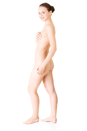 Attractive sexy naked woman. Side view. Isolated on white.  photo