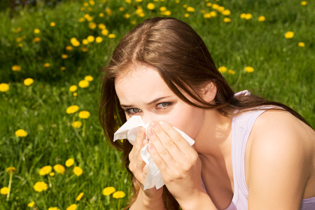 Attractive young woman outdoor with tissue. photo