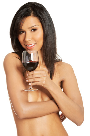 Attractive naked woman with galss of wine. Isolated on white.  photo