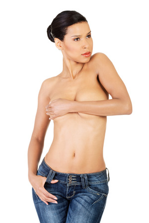 Attractive woman in jeans, topless. Isolated on white.  photo