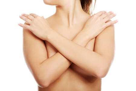 breasts: Sexy beautiful naked woman covering her breasts. Isolated on white.  Stock Photo