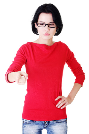 Attractive woman pointing down with eyeglasses. Isolated on white.  photo