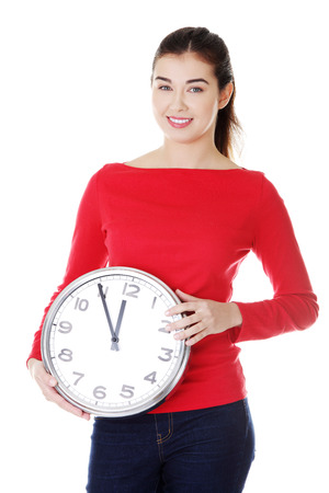 Attractive young woman holding a clock. Isolated on white.  photo