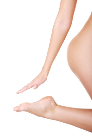 Closeup on feet and hand, buttock, naked female body. Isolated on white.  photo