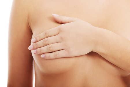 Close up on female chest. A woman is touching her breasts.  photo
