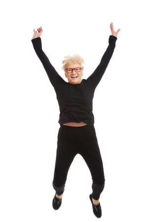 grandmas: Happy old woman jumping  Isolated on white   Stock Photo