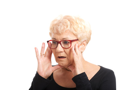 expresses: An old lady expresses shock  surprise  Isolated on white