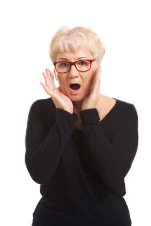 An old lady expresses shock  surprise  Isolated on white   photo