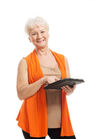 seniority: An old lady with tablet  Isolated on white  Stock Photo