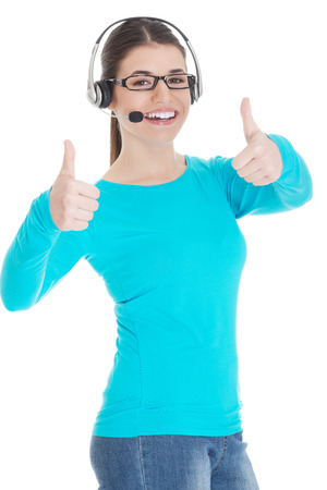 Young casual woman with headphones and microphone showing ok  Isolated on white  photo