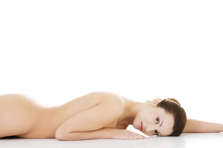 breasts erotic: Sexy fit naked woman with healthy clean skin lying down  Isolated on white