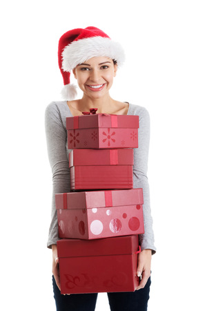beautifull woman: Beautifull woman in santa hat holding presents  Isolated on white
