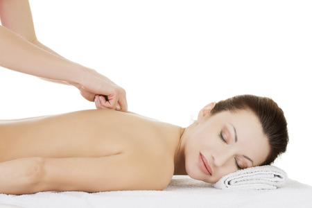 Preaty woman relaxing being massaged in spa saloon  Isolated on white