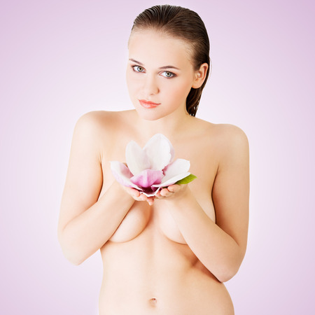 Beauty face of the young beautiful woman with flower  photo