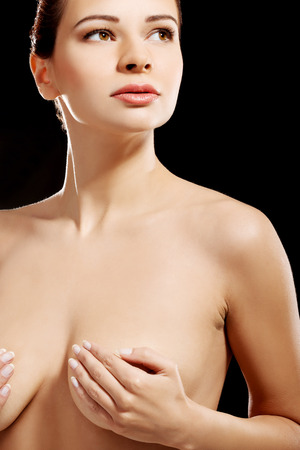 Beautiful topless woman. On black background. photo