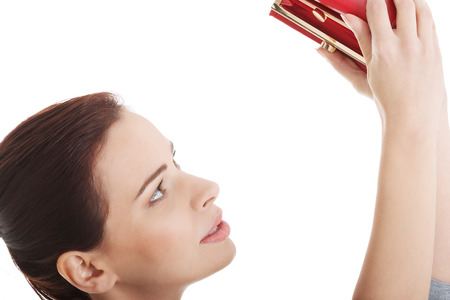 Beautiful casual woman showing her empty wallet. Isolated on white. photo