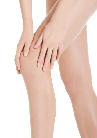 Womans smooth knee, pampiering. Spa concept. Isolated on white. photo