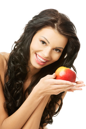 Sexy woman with red apple, isolated on white photo