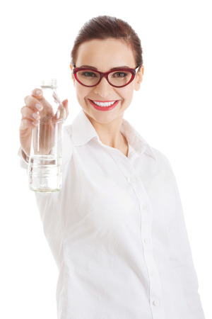 Beautiful business woman with plastic bottle of water. Isolated on white. photo
