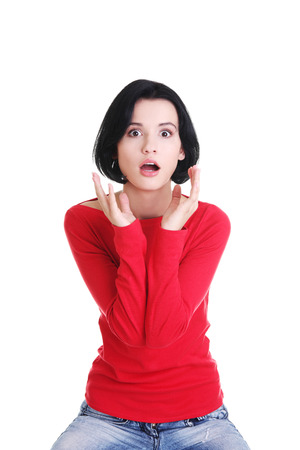 going crazy: Stressed and shocked woman is going crazy in frustration.  Stock Photo